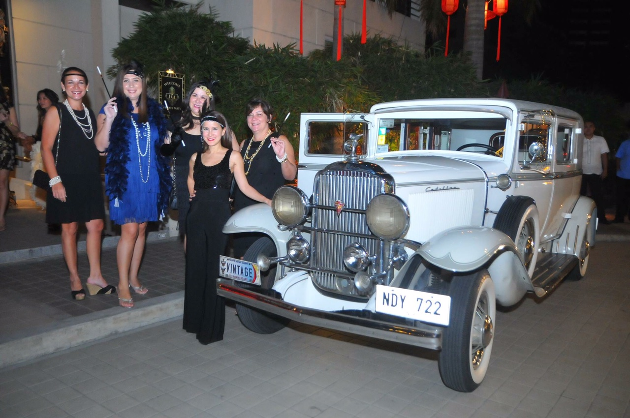 The celebrant and his wife arrived at the party in this gorgeous, vintage car.